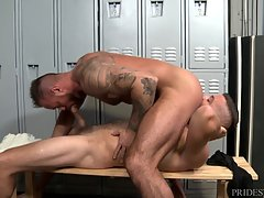 Nobody has arrived in the gym as of yet as they continue to fuck up against the lockers and on the bench. Jace fucks him until he cannot hold his load back and he pulls his throbbing cock out of Michael`s tight ass and let`s loose his built up jizz all ov