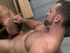 Jaxton & Aston are in the locker room and Aston is admiring how big his muscles are.  Recognizing that Aston is turned on by him, Jaxton lets him rub on his massive muscles and nuzzle in his armpits.  He then forces Aston down to his very big thick cock a