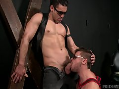 Alexander is standing alone in a dungeon room wearing leather boots, a leather vest and dark aviator sunglasses. He yells for Jack to get his ass in there and he comes in very obedient wearing leather boots and a harness along with dark glasses. Alexander